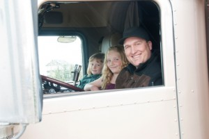 Truck driver and family in a semi truck