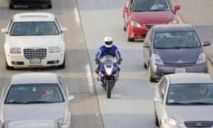 motorcycle driving between lanes