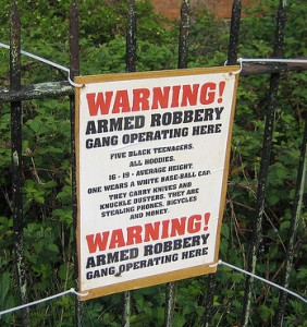 Armed robbery gang warning sign
